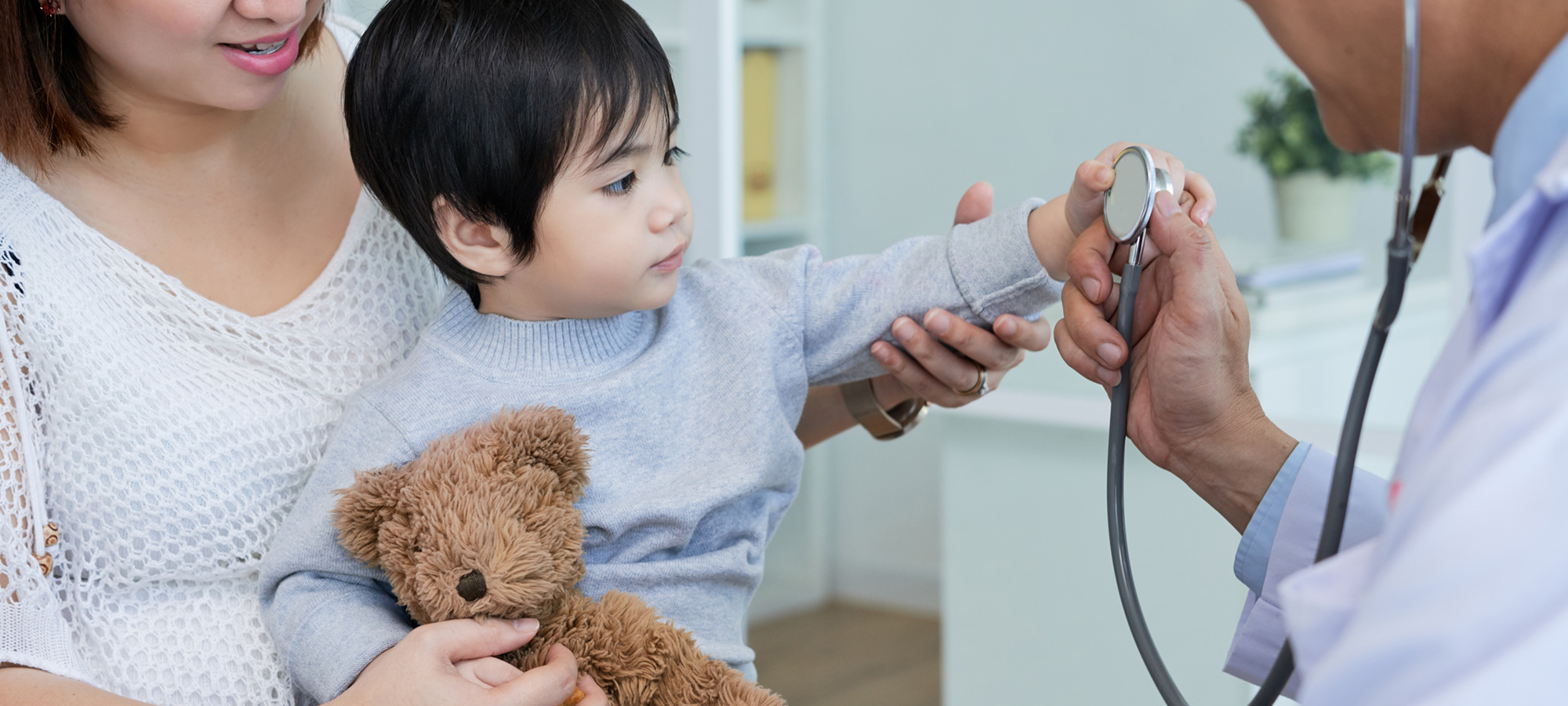 infant inspecting doctors stethoscope