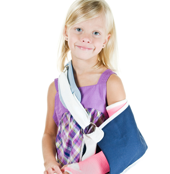 Young girl wearing arm brace and cast